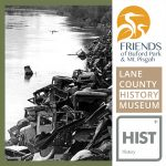 historic photo of large trash piles along riverbank
