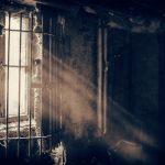 barred window in a dark room