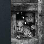 children looking through window